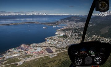 Flying over Ushuaia by Helicopter